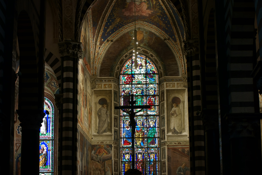 PRATO, ITALY - JANUARY 17, 2015: Santo Stefano Cathedral interior, detail of the apse with stained glass windows